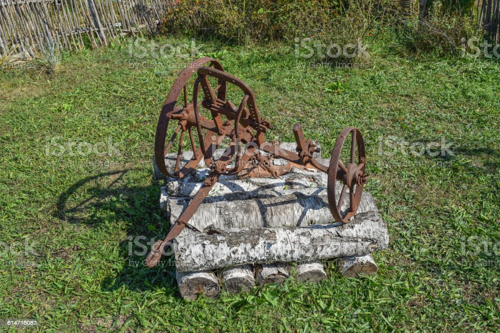 The Old Iron Plow For Digging The Garden Stock Photo & More Pictures ...