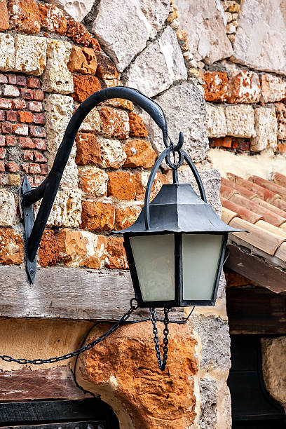 The old lantern hanging on a brick wall background.