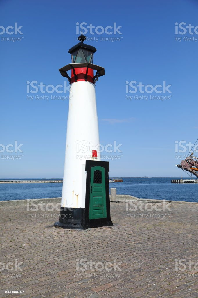 The old lighthouse on Assens Harbour stock photo