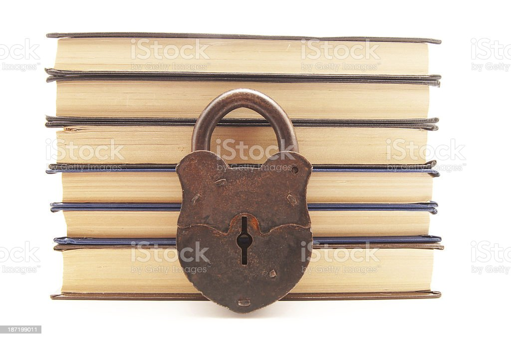 The old locks and books on a white background royalty-free stock photo