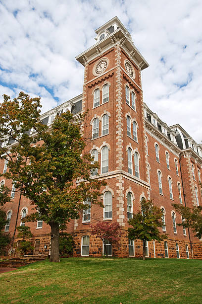 The old main building with a grass lawn stock photo