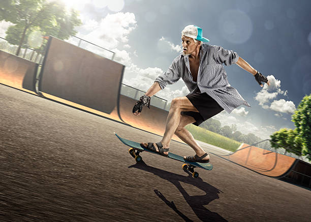 the old man is skating on skateboard - old man feet stock photos and pictures