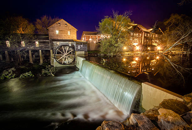 The Old Mill Restaurant In Pigeon Forge Tennessee Pigeon Forge, Tennessee, USA - March 26, 2016: The exterior of the Old Mill Restaurant and grist mill in Tennessee. pigeon forge stock pictures, royalty-free photos & images