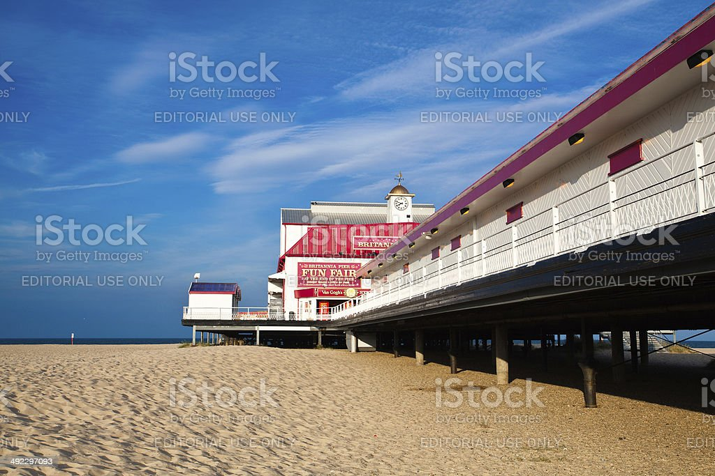 The Old pier on a beach stock photo