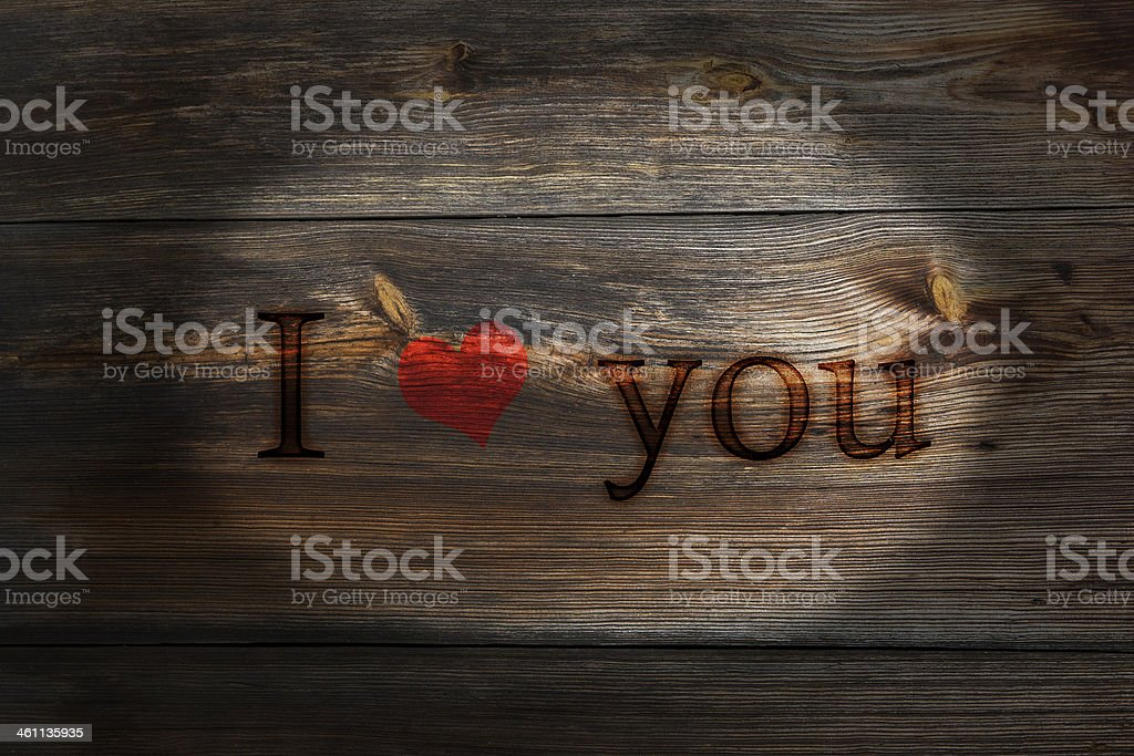 The old plank of spent inscription I love you stock photo