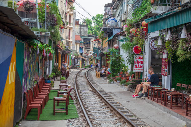 The Old Quarter, The Hanoi Street Train Tracks. Going through the narrow streets. life of locals on the street with a train Hanoi, Vietnam - june 11, 2019:The Old Quarter, The Hanoi Street Train Tracks. Going through the narrow streets. life of locals on the street with a train hanoi stock pictures, royalty-free photos & images