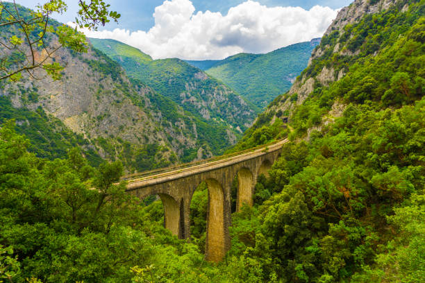 The old railway bridge of the Asopos river near village Iraklia at national park of Oiti in Central Greece The old railway bridge of the Asopos river in Greece railway bridge stock pictures, royalty-free photos & images