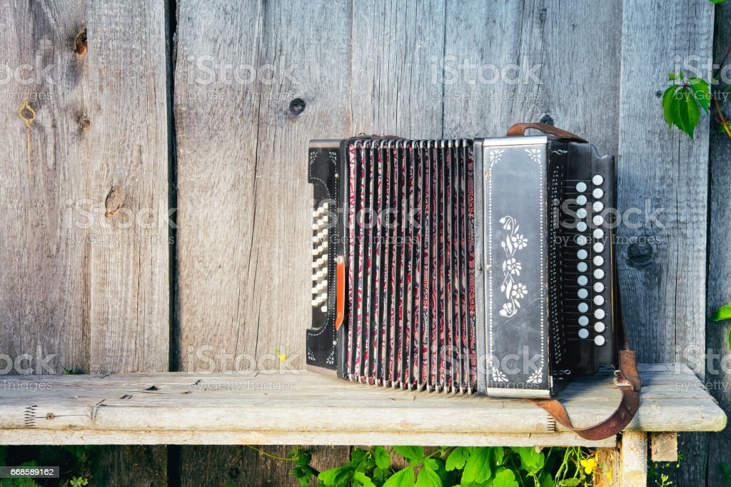 The Old Russian Accordion On The Bench Stock Photo - Download Image