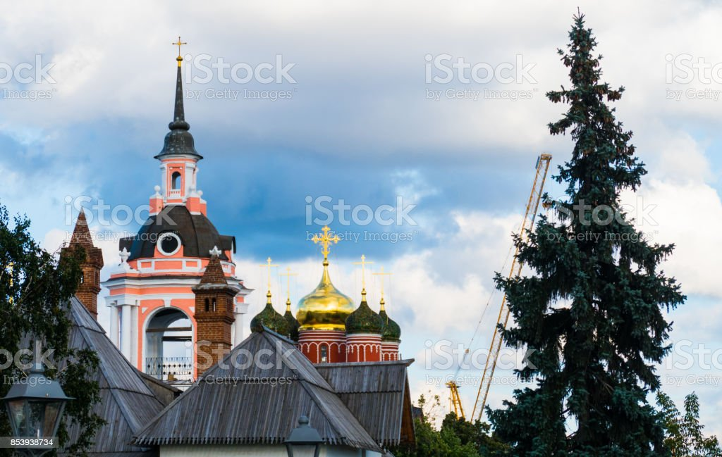 The old Russian Christian church and tree stock photo