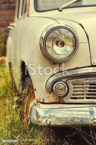 921871456 istock photo The old rusted machine. Front view where there is a spotlight with a grille and a bumper 854061362