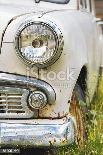 921871456 istock photo The old rusted machine. Front view where there is a spotlight with a grille and a bumper 854061444