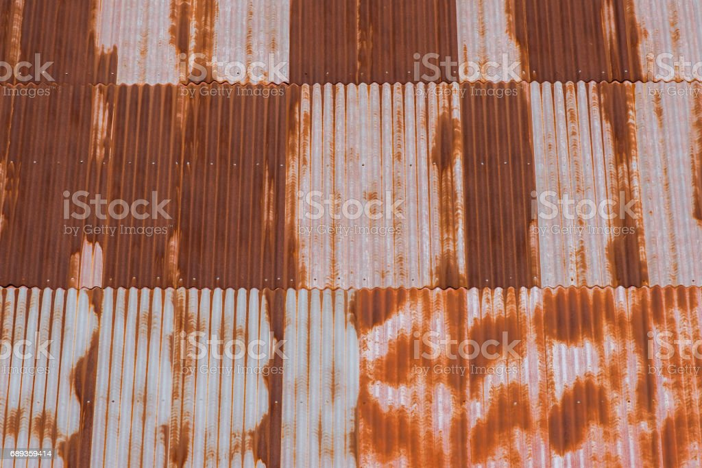 The old rusty corrugated metal iron sheets  texture background stock photo