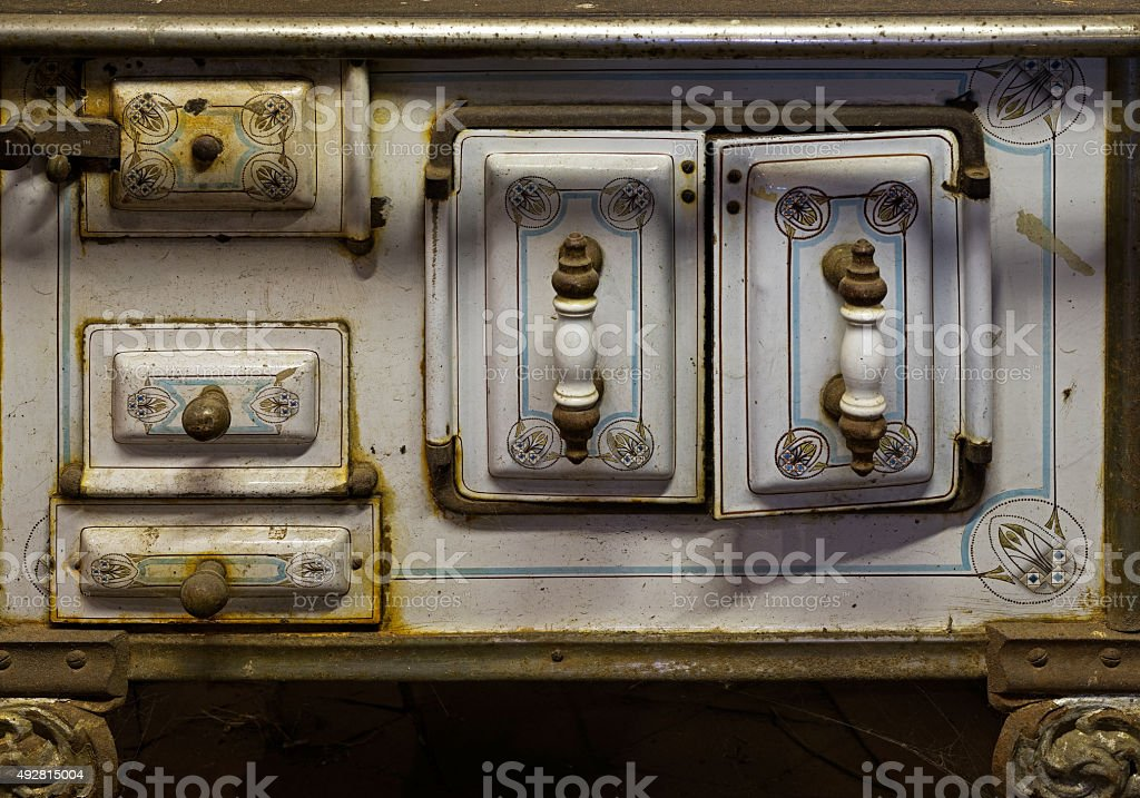 The Old rusty kitchen stove in a rustic barn stock photo