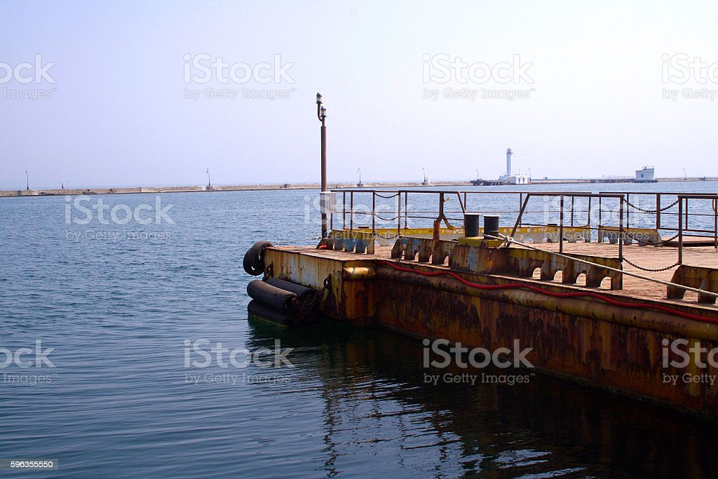 The old sea pier in the port. royalty-free stock photo