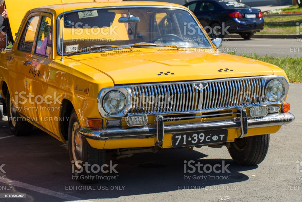 The old Soviet car GAZ-24. Yellow car of Volga brand as a taxi