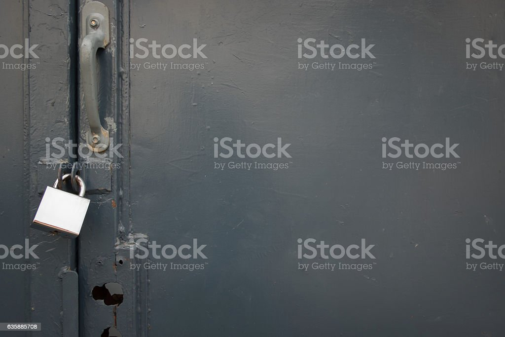 The old steel door closed with a padlock. stock photo