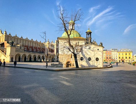 istock The Old Town Square in Cracow with the Cloth Hall and St. Adalbert Church. 1214728383