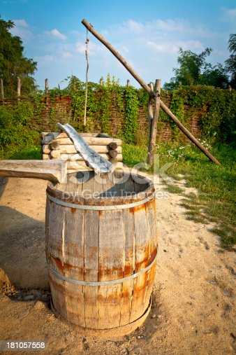 Summer view of an old wooden crane with well, gutter and  an old wooden barrel, Malopolskie province, Poland