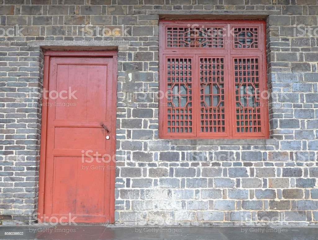 The old window in the chinese temple,Made of the wood and the red painting. stock photo