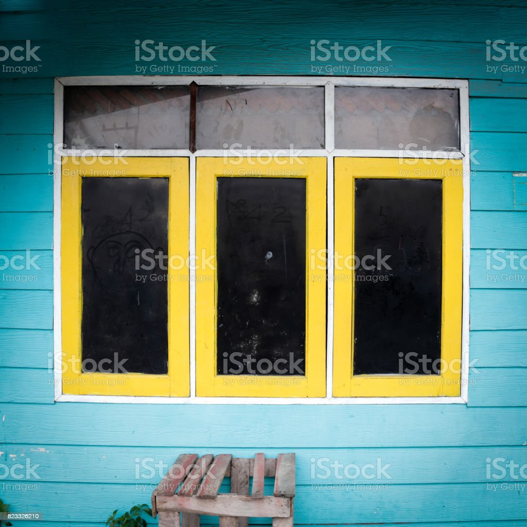 The Old Windows Yellow And Black Color With Wall Bright Blue Color ...
