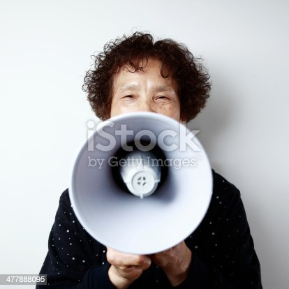 477898387istockphoto The old woman and the speaker 477888095