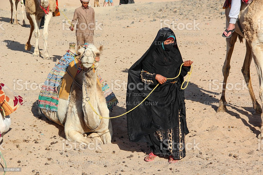 The old woman-cameleer with her camel stock photo