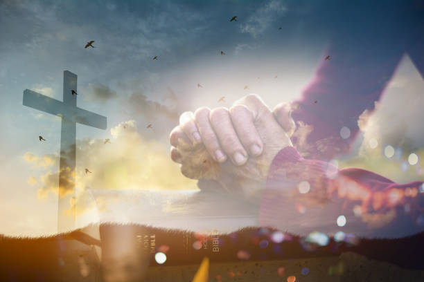 The old woman's closed hand is prayer and thank God.Christian Religion concept background. stock photo