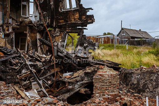 istock the old wooden burned-down house a view from inside 1035410620