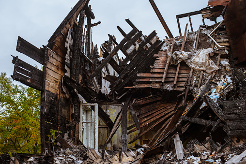 istock the old wooden burned-down house a view from inside 1035410686