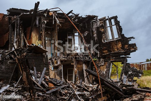 istock the old wooden burned-down house a view from inside 1035410694
