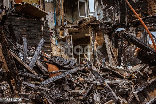 1015604978 istock photo the old wooden burned-down house a view from inside 1035410708