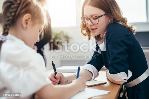 istock The older sister helps to do homework 1126036363