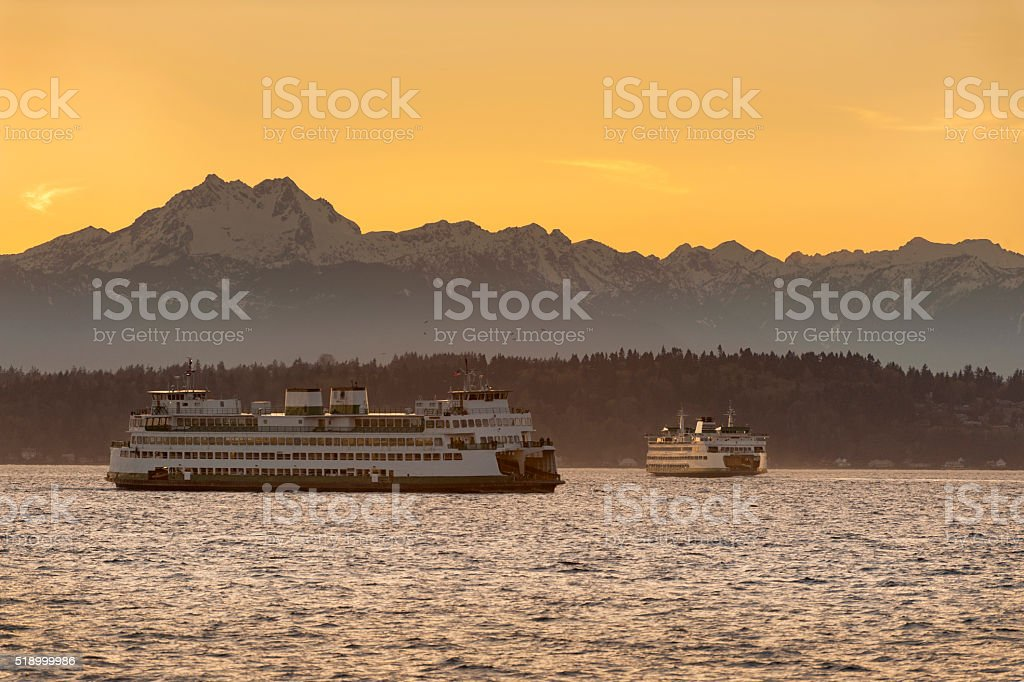 The Olympic Mountains and Ferry Boats stock photo