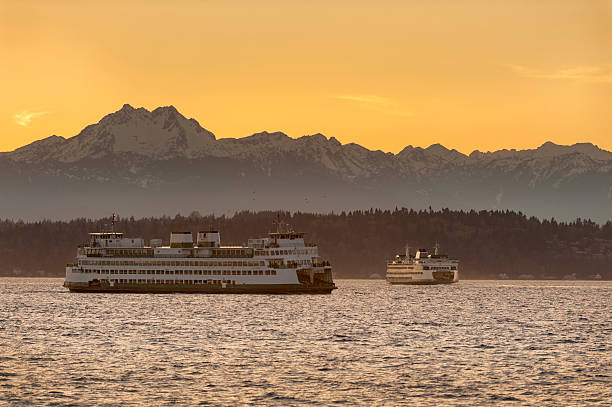 The Olympic Mountains and Ferry Boats Commuters and tourists travel from the Olympic peninsula to downtown Seattle via ferry boats during a lovely springtime sunset. puget sound stock pictures, royalty-free photos & images