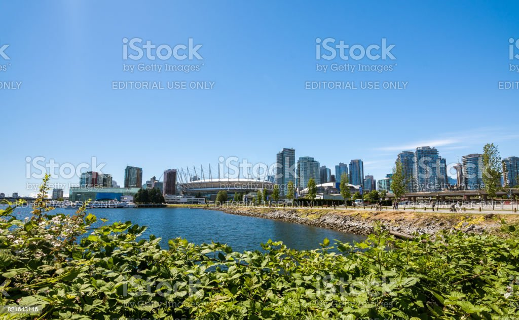 The olympic stadium and village at False creek on a sunny afternoon stock photo