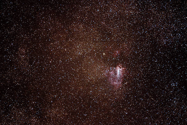 The Omega Nebula, also known as the Swan Nebula The Omega Nebula, also known as the Swan Nebula with an amateur DSLR Camera. known gas stock pictures, royalty-free photos & images