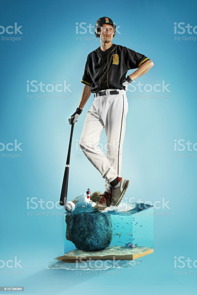 The one caucasian man as baseball player playing against blue sky stock photo