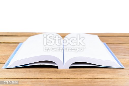 istock The open book is placed on a wooden table in white background or isolated 1079746810