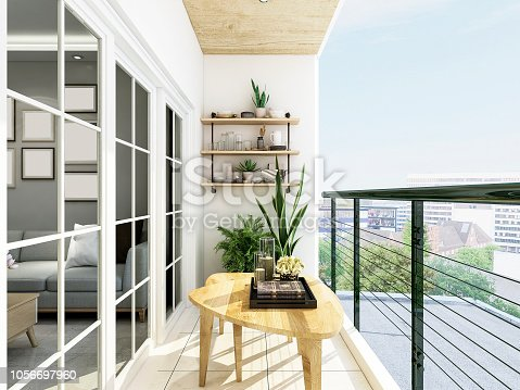 The open modern balcony design, coffee table and green plants on the balcony are very comfortable