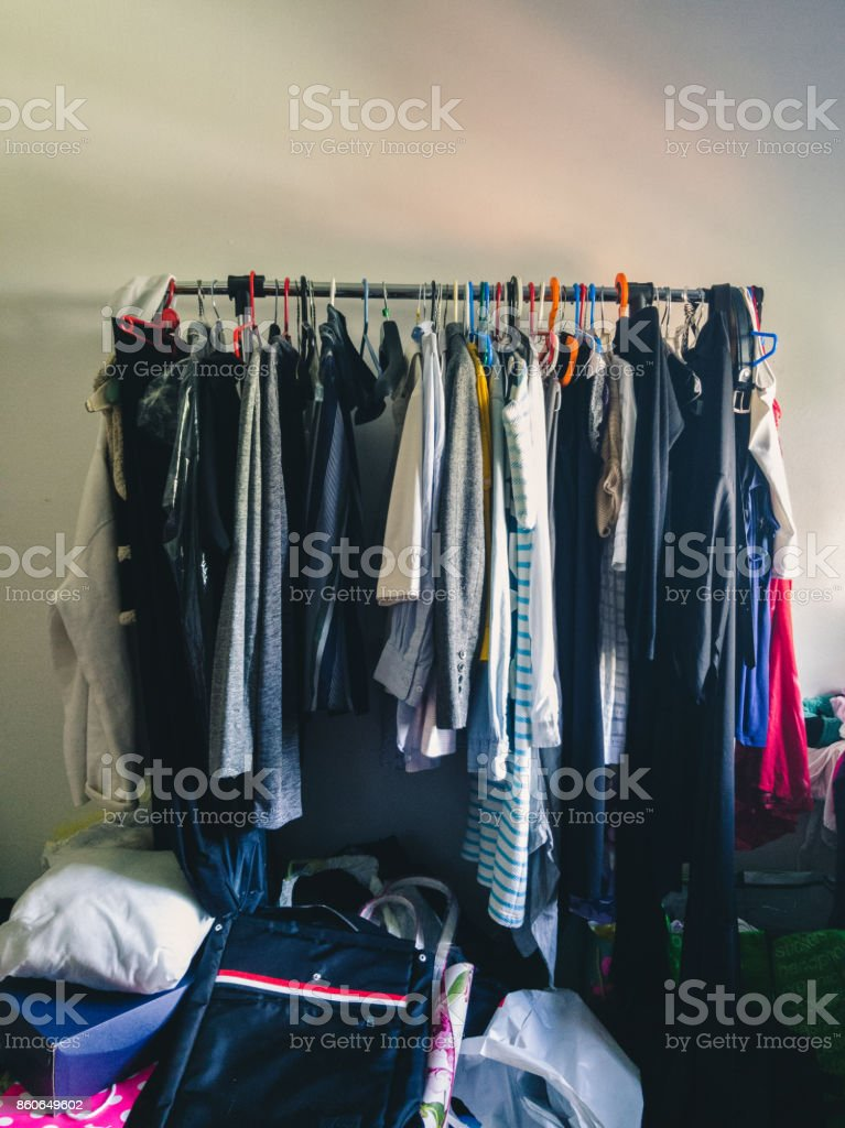 The Open Storage Wardrobe Hanger With Clothes In The Room