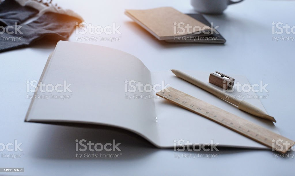 The opened book put on white desk stock photo