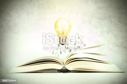 istock The opened book with alphabet letter flying out 598234544