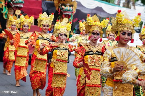 Denpasar, Bali, Indonesia - 23 Juni 2018: In the parade at Opening Ceremony of Bali Art Festival 2018, every people from various city has shown their authentic art performance from their place. In the picture, the girl performs Legong dance.