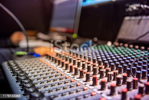 The operator controls the video and audio mixer