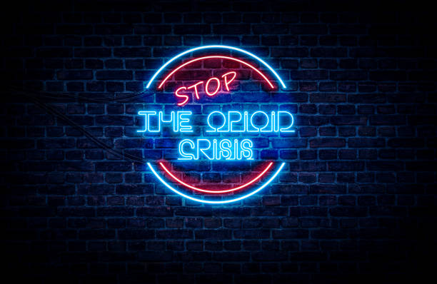 STOP The Opioid Crisis sign A neon sign in blue and red light on a brick wall background that reads: STOP THE OPIOID CRISIS opioid stock pictures, royalty-free photos & images