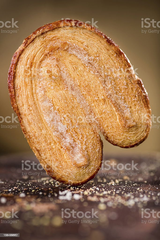 The 'Oreja(ear)' Mexican Pastry with Crumbs on a cutting board. stock photo