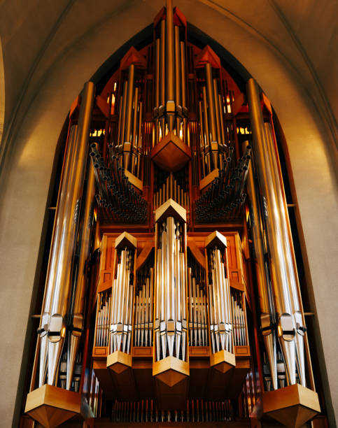 The organ inside Hadlgrimskirkya is a Lutheran church in Reykjavik, the capital of Iceland. The organ inside Hadlgrimskirkya is a Lutheran church in Reykjavik, the capital of Iceland. High quality photo Hallgrímskirkja church stock pictures, royalty-free photos & images