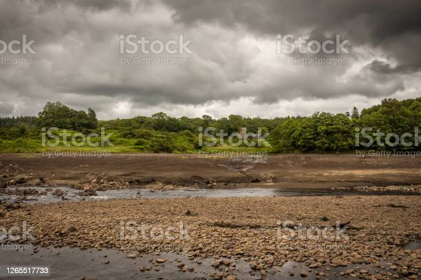 Photo of The original Water of Ken river bed exposed and the Earlstoun Castle ruin