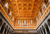 the ornate ceiling inside the basilica of St Paul outside the walls in Rome