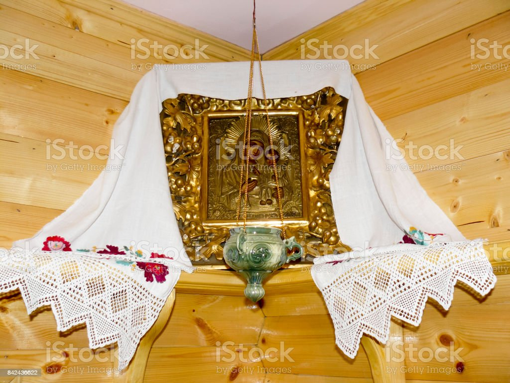 The Orthodox icon of the Mother of God and Jesus with the lamp in the corner of the room stock photo